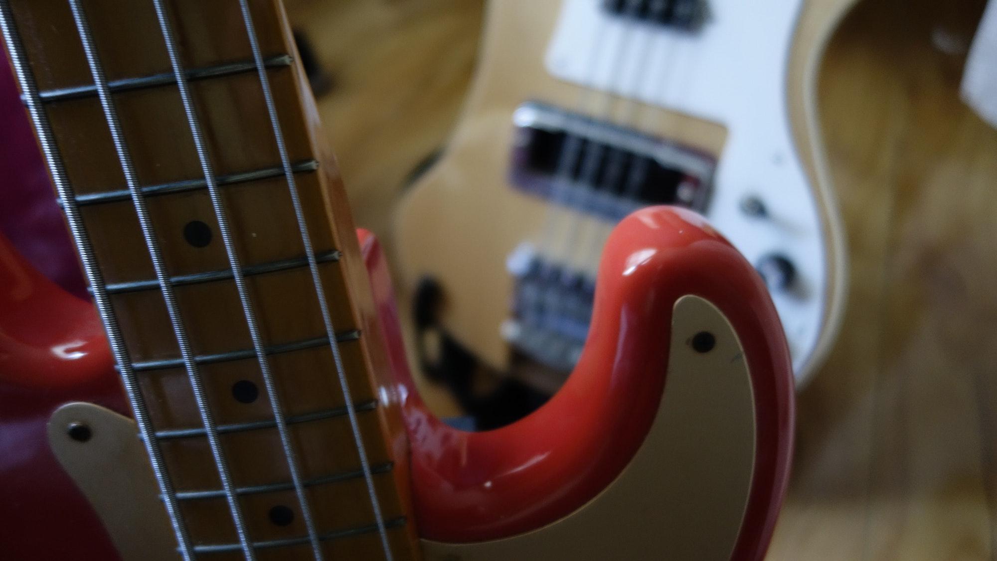 Closeup High Angle View Of Bass Guitars