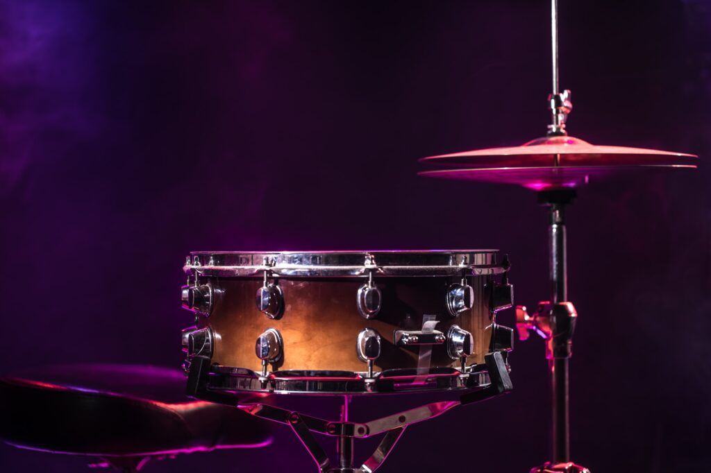 Drums and drum set. Beautiful blue and red background.