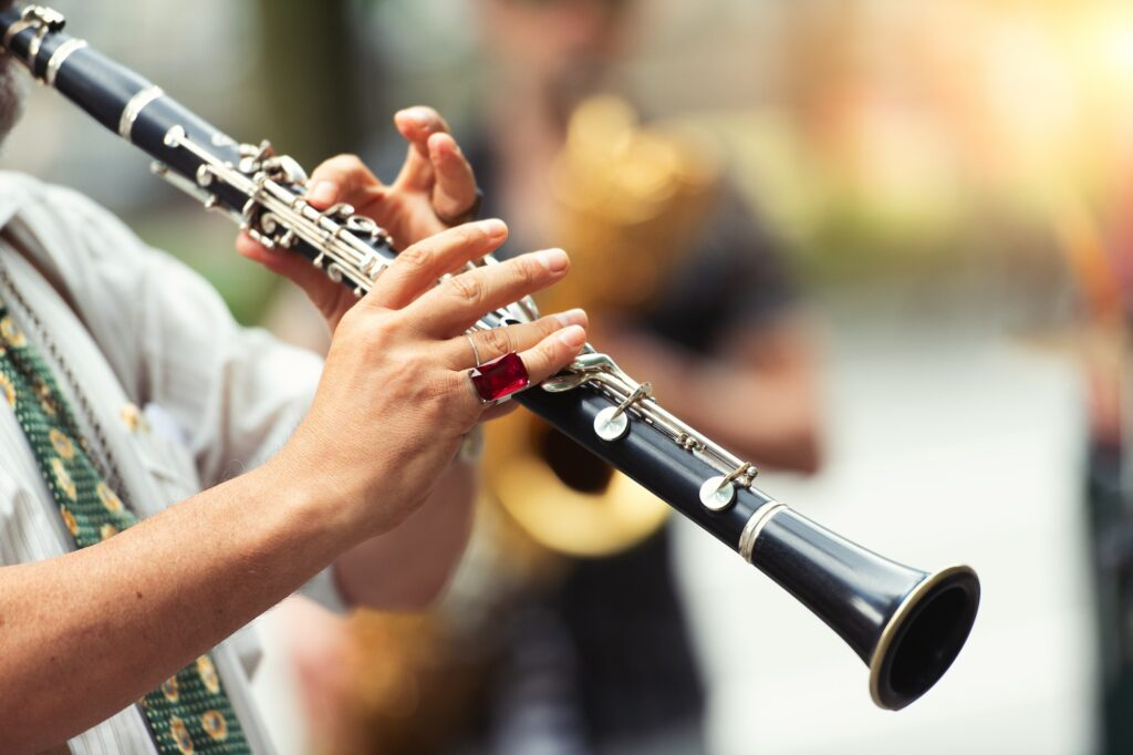 Street musician playing the clarinet
